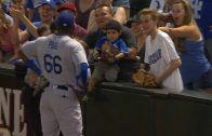 LAD@ARI-Puig-attempts-to-give-a-young-fan-a-ball-attachment