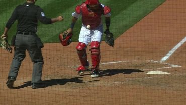 Molina-has-a-baseball-stick-to-his-gear-attachment