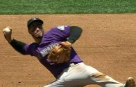 Arenado-dives-throws-out-Blach-from-his-back-attachment