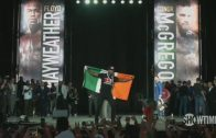 Floyd-Mayweather-Gets-Irish-Flag-From-Fan-Conor-McGregor-Grabs-Floyds-Backpack-ESPN-attachment