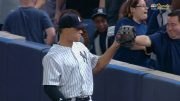 Judge-gives-fan-a-high-five-near-the-stands-attachment