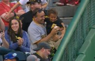Marte-snags-fly-ball-gives-away-souvenir-attachment