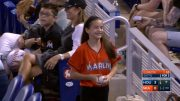 Fans-embrace-after-scrambling-for-foul-ball-attachment